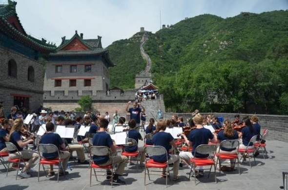 Preucil School of Music String Orchestra performing on the Great Wall